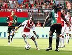 Nederland, Nijmegen, 19 augustus 2012.Eredivisie.Seizoen 2012-2013.N.E.C.-Ajax (1-6).Jody Lukoki van Ajax in actie met bal. Rechts Evander Sno van N.E.C.