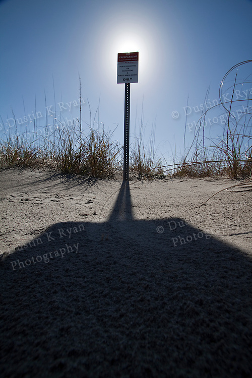 keep out sign Folly Beach South Carolina blue sky