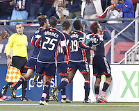 New England Revolution midfielder Diego Fagundez (14) celebrates his goal with teammates. In a Major League Soccer (MLS) match, the New England Revolution (blue) defeated Chicago Fire (red), 1-0, at Gillette Stadium on October 20, 2012.