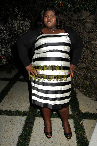"GABOUREY ""GABBY"" SIDIBE.3rd Annual Women In Film Pre-Oscar Party held at a Private Residence in Beverly Hills, California, USA, .4th March 2010..full length black and white striped stripes dress cardigan hands on hips open toe shoes .CAP/ADM/BP.©Byron Purvis/AdMedia/Capital Pictures."