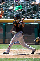 Darren Ford (9) of the Fresno Grizzlies at bat against the Salt Lake Bees at Smith's Ballpark on May 26, 2014 in Salt Lake City, Utah.  (Stephen Smith/Four Seam Images)