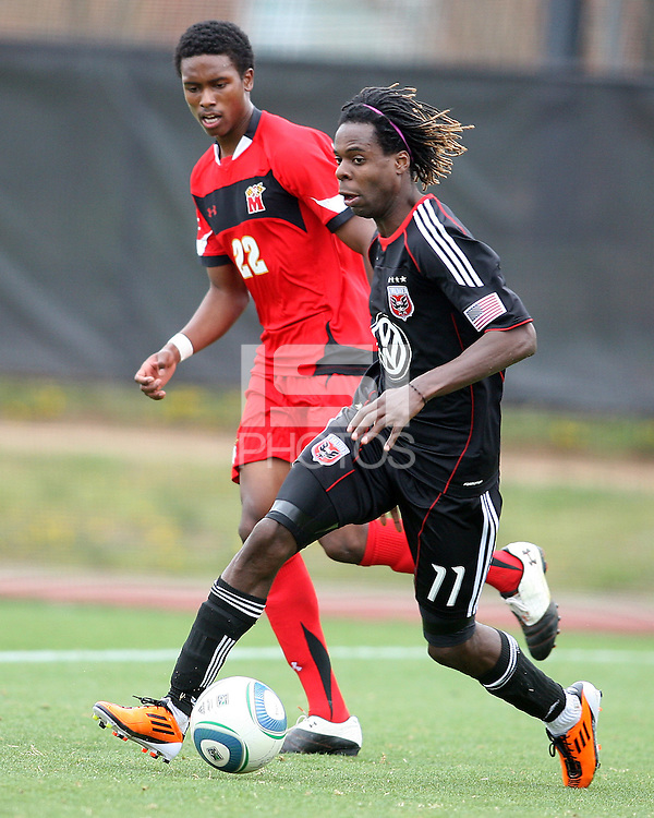 Joseph Ngwenya (11) of D.C. United moves past London Woodbury (22)  during a scrimmage against the University of Maryland at Ludwig Field, University of Maryland, College Park, on April  10 2011. D.C. United won 1-0.