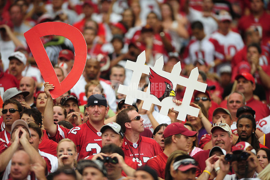 Sept. 13, 2009; Glendale, AZ, USA; Arizona Cardinals fans hold up a sign for defense during the game against the San Francisco 49ers at University of Phoenix Stadium. San Francisco defeated Arizona 20-16. Mandatory Credit: Mark J. Rebilas-