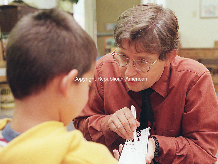 WINSTED, CT 9/14/98--0914TK03.tif  (left to right:)Four year old Christopher Hayden eyes are examined by Torrington Ophthalmologist William Ehlers in the Winsted Child Care Center located at the Temple Beth Israel building in Winsted. The free eye screening for 3-5 year olds was sponsored by the Charlotte Hungerford Hospital of Torrington. Approximately 25 children took advantaged of the program.--TOM KABELKA staff photo for REPORTERS NAME / STANDALONE PHOTO  (Filed in Scans/Scan-In)