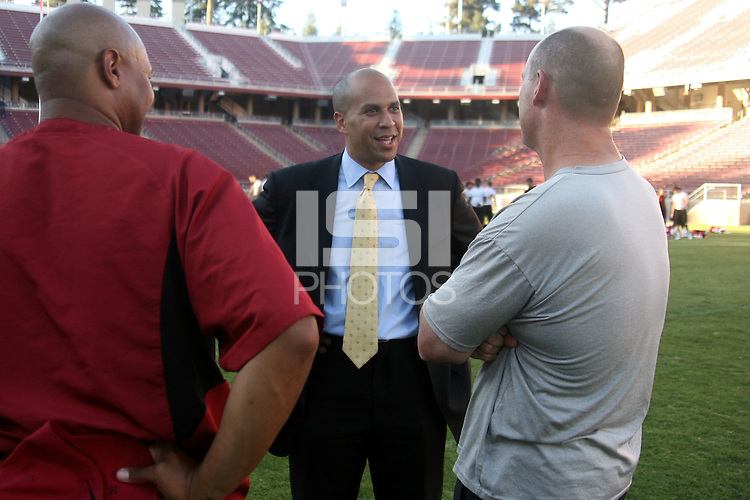 STANFORD, CA - SEPTEMBER 25:  Mayor Cory Booker, former Stanford Cardinal football player, speaks with former teammates David Shaw and Chris Dalman during a visit on September 25, 2008 at Stanford Stadium in Stanford, California.