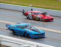 Sep 25, 2016; Madison, IL, USA; NHRA pro mod driver Michael Biehle II (near) races alongside Peter Farber during the Midwest Nationals at Gateway Motorsports Park. Mandatory Credit: Mark J. Rebilas-USA TODAY Sports