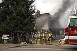 04/01/13-- Firefighters from Tualatin Valley Fire & Rescue respond to a house fire along Southwest Tigard Street in Tigard. According to witnesses the fire started around 1 PM. .Photo by JaIme Valdez