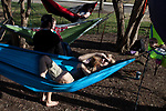 Patrick Connolly lays in a hammock with Clover the dog with the Hammock Club outside of Morton Hall on Februrary 24, 2017.