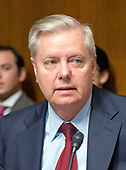 United States Senator Lindsey Graham (Republican of South Carolina prior to hearing Christopher A. Wray testify on his nomination to be Director of the Federal Bureau of Investigation (FBI) before the US Senate Committee on the Judiciary on Capitol Hill in Washington, DC on Wednesday, July 12, 2017.<br /> Credit: Ron Sachs / CNP<br /> (RESTRICTION: NO New York or New Jersey Newspapers or newspapers within a 75 mile radius of New York City)