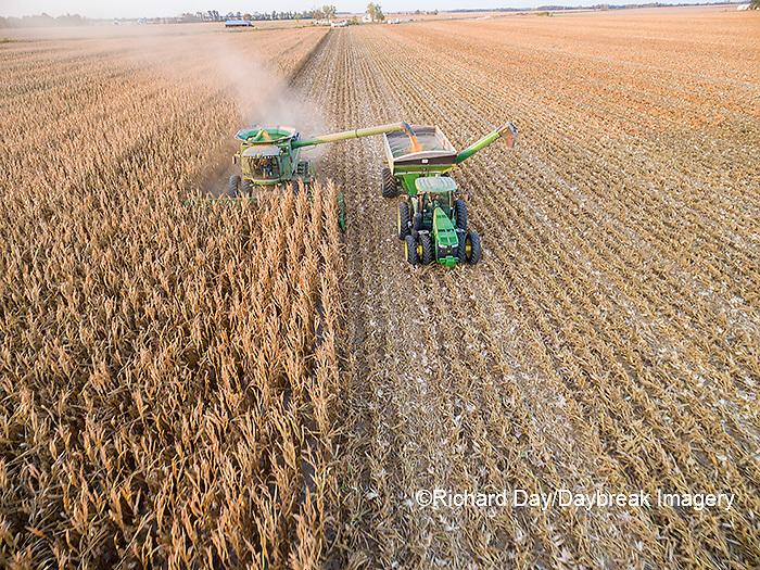 63801-08220 Corn Harvest, John Deere combine unloading corn into grain cart while harvesting - aerial Marion Co. IL
