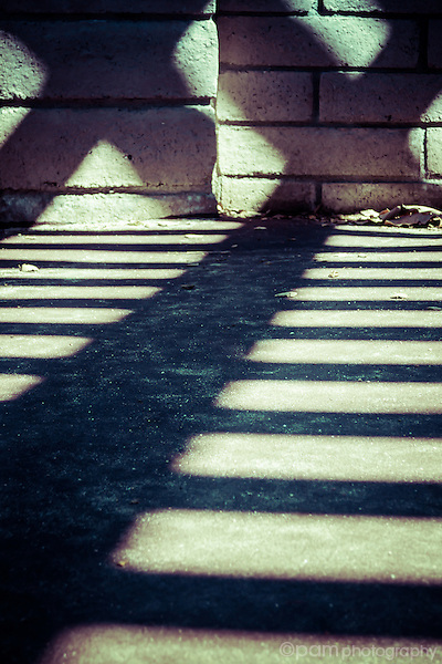 Abstract of shadows with straight black line leading to two X's