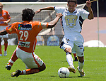 Chiapas Jaguares defender Melvin Brown fights for the ball against UNAM Pumas striker Gerardo Galindo during their soccer match at the University Stadium, April 02, 2006. UNAM Pumas won 2-1 to Chiapas Jaguares... Photo by © Javier Rodriguez