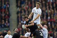 Joe Launchbury of England disrupts the lineout jump of Sam Whitelock of New Zealand during the QBE Autumn International match between England and New Zealand at Twickenham on Saturday 01 December 2012 (Photo by Rob Munro)