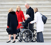 Washington, DC - January 20, 2009 -- Lynne Cheney (L) Jill Biden (2nd L), and Vice President Joe Biden (R) walk with former Vice President Dick Cheney (seated) as he departs on the East Front of the US Capitol Building after Barack Obama was sworn in as the 44th President of the United States in Washington, DC, USA 20 January 2009.  Obama defeated Republican candidate John McCain on Election Day 04 November 2008 to become the next U.S. President..Credit: Tannen Maury - Pool via CNP