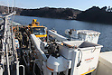 OSHIMA, Japan - Japanese utility repair vehicles and personnel aboard a U.S. Navy landing craft head for the island of Oshima, March 27. The 31st Marine Expeditionary Unit and Amphibious Squadron 11 picked up the vehicles from the port here and delivered food, water, comfort items and the vehicles to residents on the isolated island. The island of Oshima has been cut off from the mainland since the earthquake and tsunami March 11. The operation demonstrated the expeditionary capabilities in ship-to-shore amphibious operations. Marines and Sailors of the 31st MEU are conducting humanitarian aid and disaster relief missions in northeast Japan assisting the Japanese Self Defense Forces in their ongoing operations. (Photo by USMC/AFLO) [0006]