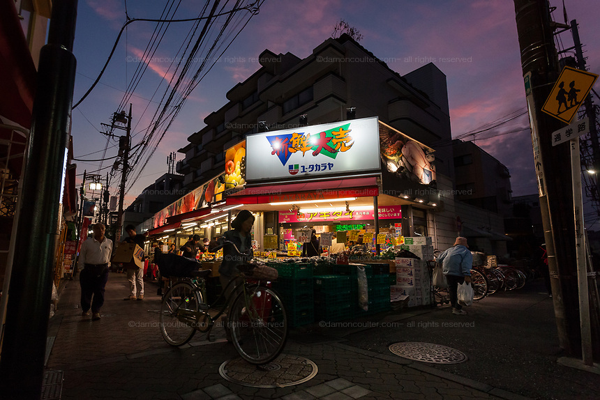 A supermarket  at sunset in the backstreets of Koenji, Tokyo, Japan. Wednesday October 30th 2019