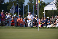 Gainesville, VA - August 2, 2015: Carl Pettersson hits a great shot out of the crowd to save parr on the 16th hole at the Robert Trent Jones Golf Club in Gainesville, VA. August 2, 2015.  (Photo by Philip Peters/Media Images International)