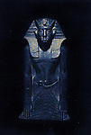Black granite Royal statue in the museum in Luxor.The town of Luxor occupies the eastern part of a great city of antiquity which the ancient Egytians called Waset and the Greeks named Thebes.