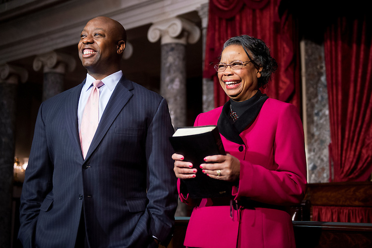 UNITED STATES - DECEMBER 02: Sen. Tim Scott, R-S.C., and his mother Frances, wait to conduct a mock swearing-in ceremony with Vice President Joe Biden in the Capitol's Old Senate Chamber, December 2, 2014. Scott was sworn in to serve the remainder of his term since he was appointed to the seat after Sen. Jim DeMint, R-S.C., retired. (Photo By Tom Williams/CQ Roll Call)