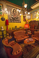 Eclectic Period Room at Papaya Vintage - If Indiana Jones teamed up with the Oddities crew and set up a junk shop, Papaya Vintage is probably what it would look like. Papaya Vintage is like no other shop you have even seen - a warehouse in the Lat Phrao area of Bangkok brimming with collectables, action figures, junk, exquisite antiques, and more. The adventure begins as your eyes zoom in on toys and objects from the past, reminders of moments of your childhood. Think: Darth Vader and Ultraman figures, gazing onto James Dean forever posing cool next to a doorway. Climbing the upper floors is like moving randomly through time. You can't help but notice the vintage Vespas and manaquins of comic characters Flash, Wolverine, Green Lantern and Batman, all standing next to toy cars, fluffy sofas, bean bag chairs, and grandma's lampshade.