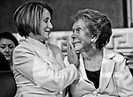 Speaker of the House Nancy Pelosi, comforts former First Lady Nancy Reagan after her emotional speech during the ceremony to unveil a statue of former President Ronald Reagan that will become part of the National Statuary Hall Collection in the U.S. Capitol on June 3, 2009.