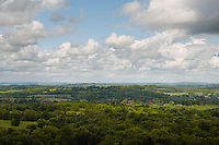 View over Ashdown Forest, Sussex, UK, May 20, 2017. Picturesque Ashdown Forest stretches across the countries of Surrey, Sussex and Kent, and is the largest open access space in the South East of England. It is famous as the geographical inspiration for the Winnie the Pooh stories and is popular with fans of the characters.
