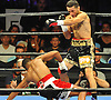 Sergio Mora, right, sends Daniel Jacobs of Brooklyn to the canvas during a Premier Boxing Champions match at the Barclays Center on Saturday, August 1, 2015. Jacobs rebounded from the knockdown and won the bout by TKO in the second round. <br /> <br /> James Escher