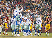 Dallas Cowboys kicker Dan Bailey (5) leaps into the arms of his teammates after kicking the game-winning filed goal with nine seconds left in the game against the Washington Redskins at FedEx Field in Landover, Maryland on Monday, December 7, 2015.  The Cowboys won the game 19-16.<br /> Credit: Ron Sachs / CNP