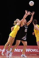 23.09.2012 Silver Ferns Cathrine Latu and Australian Laura Geitz in action during the third netball test match between the Silver Ferns and the Australian Diamonds at CBS Canterbury Arena in Christchurch. Mandatory Photo Credit ©Michael Bradley.