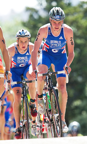 04 JUN 2011 - MADRID, ESP - Alistair Brownlee leads brother Jonathan Brownlee up the hill during the bike at the Madrid round of triathlon's ITU World Championship Series .(PHOTO (C) NIGEL FARROW)