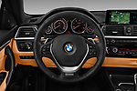 Car pictures of steering wheel view of a 2018 BMW 4 Series Luxury 4 Door Coupe