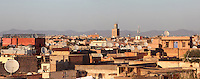 Rooftop view of the Medina quarter, Marrakech, Morocco. The Koutoubia mosque minaret dominates the skyline, satellite dishes litter the rooftops. Picture by Manuel Cohen