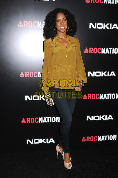 Kelly Rowland.Roc Nation Pre-Grammy Brunch held at Soho House, West Hollywood, California, USA, 11th February 2012..full length  jeans leopard print bag beige pee toe shoes smiling  yellow mustard shirt blouse .CAP/ADM/BP.©Byron Purvis/AdMedia/Capital Pictures.