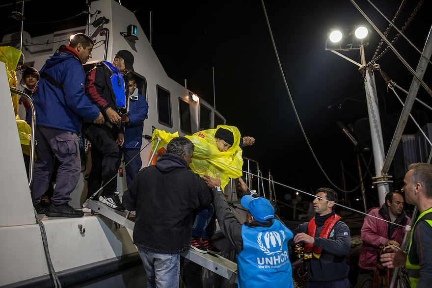 October 28, people who were rescued from a drowning boat by the Greek Coast were transported to the Port of Molyvos on a story night.