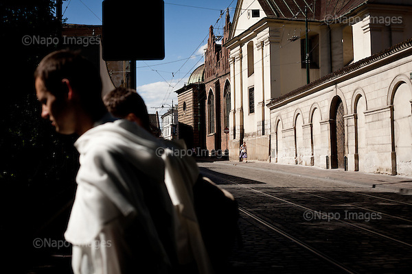 KRAKOW, POLAND, SEPTEMBER 12, 2011:.Young monks are walking in central Krakow. This town is full of churches and christian tradition..(Photo by Piotr Malecki / Napo Images) ..KRAKOW, 9/2011:.Mlodzi ksieza w centrum miasta.Fot: Piotr Malecki / Napo Images