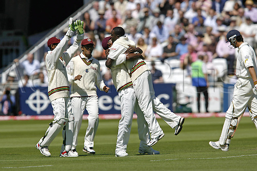 18 May 2007: West Indies bowler Jerome Taylor is congratulated by his team mates after claiming Cook's wicket on day two of the first npower test match between England and West Indies at Lords, London. Photo: Neil Tingle/Actionplus...070518 cricketer cricket player joy celebrate celebration