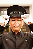 VIETNAM, Hanoi, Sofitel Metropole Hotel, one of the hotel chauffeurs in front of the hotel
