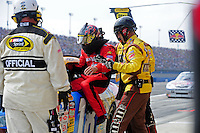 Oct. 11, 2009; Fontana, CA, USA; NASCAR Sprint Cup Series driver David Gilliland climbs into the car driven by Kyle Busch (not pictured) after he was pulled from his car due to flu like symptoms during the Pepsi 500 at Auto Club Speedway. Mandatory Credit: Mark J. Rebilas-