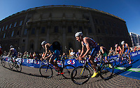 25 AUG 2013 - STOCKHOLM, SWE - Alistair Brownlee (GBR) (third from the left, #4, in blue, white and red) of Great Britain on the bike during the men's ITU 2013 World Triathlon Series round in Gamla Stan, Stockholm, Sweden (PHOTO COPYRIGHT © 2013 NIGEL FARROW, ALL RIGHTS RESERVED)
