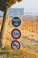 Signs indicating the wine cellar shop tasting room and traffic warning signs at Chateau des Fines Roches, Chateauneuf-du-Pape, Vaucluse, Rhone, Provence, France