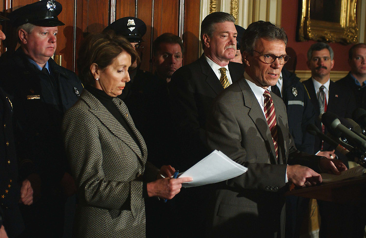 "2/14/03.HOMELAND SECURITY FUNDING--House Minority Leader Nancy Pelosi, D-Calif., and Senate Minority Leader Tom Daschle, D-S.D., during an event at the U.S. Capitol, with Harold A. Schaitberger (mustache, middle) of the International Association of Fire Fighters, on a letter the two leaders sent today to President Bush saying that, ""We are deeply concerned that your Administration has failed to commit the resources needed to address America's urgent homeland security needs."" .CONGRESSIONAL QUARTERLY PHOTO BY SCOTT J. FERRELL"