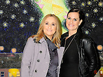 Melissa Etheridge poses for a photo with her partner Linda Wallem, creator of Showtimes series Nurse Jackie at NMWA in front of one of Melissa favorite paintings by Hollis Sigler called &quot;To Kiss The Spirits&quot; at the National Museum of Women in the Arts in Washington DC. Sunday Nov. 4th. Grammy award winner Melissa Etheridge was presented with The Excellence in the Performing Arts award from the National Museum of Women in the Arts (NMWA). Etheridge  also performed on the piano and then an acoustic set on guitar for an intimate audience of about 400 people. Photo &copy;Suzi Altman/For NMWA Grammy award winner Melissa Etheridge is presented with the National Museum of Women in the Arts&rsquo; (NMWA) Award for Excellence in the Performing Arts in Washington DC. Sunday Nov. 4, 2012. Etheridge also performed on the piano and then an acoustic set on guitar for an intimate audience of about 300 people. Photo &copy;Suzi Altman/For NMWA<br />