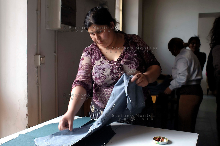 """Rome April 10 2008    .Ancient Tailor House of Rome, composed by a group of young Romanian Romani and Slavic  dressmakers.""""Antica Sartoria Rom"""""""