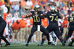Wake Forest Demon Deacons quarterback Sam Hartman (10) looks to pass the football during first half action against the Clemson Tigers at BB&T Field on October 6, 2018 in Winston-Salem, North Carolina. (Brian Westerholt/Sports On Film)