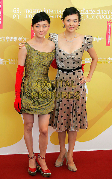 "XUN ZHOU & ZIYI ZHANG.63rd Venice Film Festival,.Photocall for film ""The Banquet"",.Venice, Italy, 3rd September 2006..full length black and grey silver velvet dress polka dot green red golves wedges.Ref: OME .www.capitalpictures.com.sales@capitalpictures.com.©GPA/Omega/Capital Pictures."