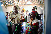 MPHANDULA, MALAWI - AUGUST 20: Unidentified women sing and dance during a church service at the African Abraham Church on August 20, 2006 in Mphandula village, about 30 miles outside Lilongwe, Malawi. Mphandula is a poor village in Malawi, without electricity or clean water. Nobody owns a car or a mobile phone. Most people live on farming. About 7000 people reside in the village and the chief estimates that there are about five-hundred orphans. Many have been affected by HIV/Aids and many of the children are orphaned. A foundation started by Madonna has decided to build an orphan center in the village through Consol Homes, a Malawi based organization. Raising Malawi is investing about 3 million dollars in the project and Madonna is scheduled to visit the village in October 2006. Malawi is a small landlocked country in Southern Africa without any natural resources. Many people are affected by the Aids epidemic. Malawi is one of the poorest countries in the world and has about 1 million orphaned children. (Photo by Per-Anders Pettersson)