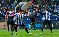 Leeds United's Patrick Bamford (centre) competing with Sheffield Wednesday's Dominic Iorfa (right) in the penalty area<br /> <br /> Photographer Andrew Kearns/CameraSport<br /> <br /> The EFL Sky Bet Championship - Sheffield Wednesday v Leeds United - Saturday 26th October 2019 - Hillsborough - Sheffield<br /> <br /> World Copyright © 2019 CameraSport. All rights reserved. 43 Linden Ave. Countesthorpe. Leicester. England. LE8 5PG - Tel: +44 (0) 116 277 4147 - admin@camerasport.com - www.camerasport.com