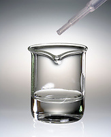 HYDROGEN PEROXIDE REACTS WITH POTASSIUM IODIDE (1 of 2)<br /> A Decomposition Reaction<br /> A beaker of 30% Hydrogen Peroxide and a dropper with a .5M solution of Potassium Iodide. H2O2 can be stored without significant decomposition since its reaction rate is very slow.