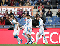 Napoli&rsquo;s Dries Mertens, right, celebrates with teammates, from left, Marko Rog, Jose' Maria Callejon and Lorenzo Insigne after scoring his first goal as Roma&rsquo;s goalkeeper Wojciech Szczesny tries to stop him during the Italian Serie A football match between Roma and Napoli at Rome's Olympic stadium, 4 March 2017. <br /> UPDATE IMAGES PRESS/Isabella Bonotto