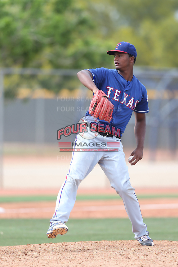 Victor Payano #48 of the Texas Rangers pitchers during a Minor League Spring Training Game against the Kansas City Royals at the Kansas City Royals Spring Training Complex on March 20, 2014 in Surprise, Arizona. (Larry Goren/Four Seam Images)